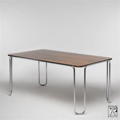 tubular steel dining table in the style of the bauhaus