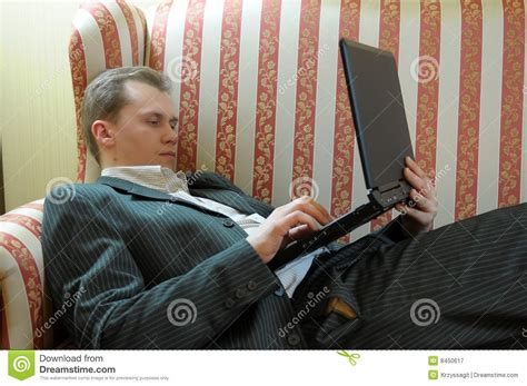 man reclining man reclining with laptop royalty free stock photography