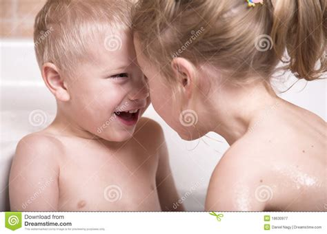 Littl Boy And Girl Have Fun In The Bathtub Stock Image