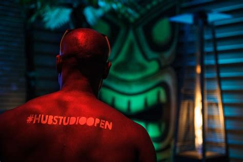 Glow In The Dark Tattoos Orlando | shirtless male models were sted with temporary glow in