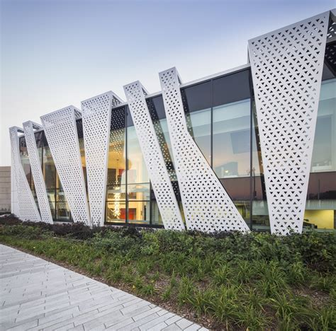 design pattern facade exles perforated building facades that redefine traditional design