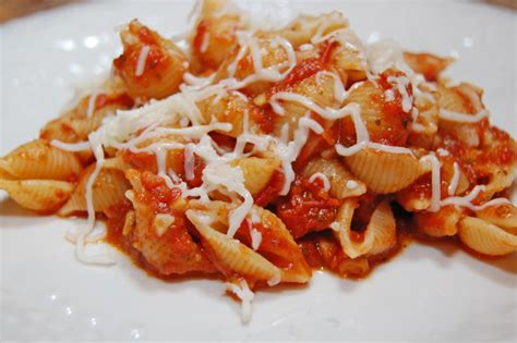 macaroni and cheese macaroni and tomatoes eat at home pesto and crushed tomato shells 3 ingredients 15