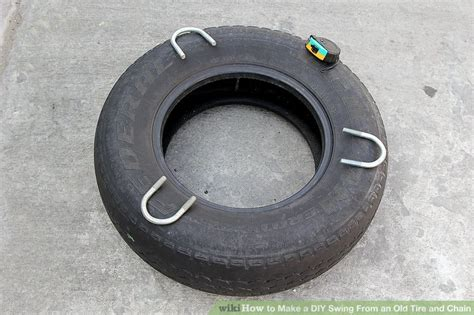 how to make a tire swing with chains how to make a diy swing from an old tire and chain 13 steps