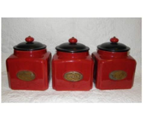 red ceramic canisters for the kitchen object moved