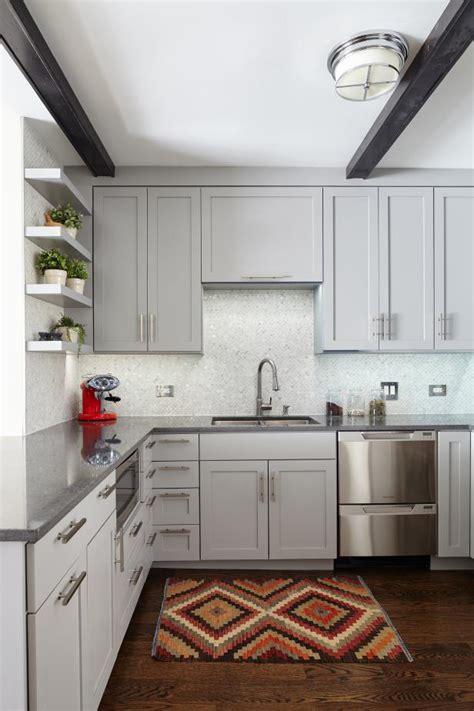 transitional kitchen features white mosaic tile backsplash