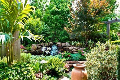 backyard garden oasis lush outdoor oasis with flagstone walkway and waterfall hgtv