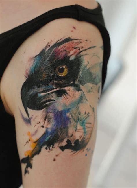 aquarell adler tattoo an der schulter von dopeindulgence