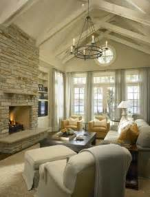 vaulted ceiling living room floor to ceiling brick fireplace transitional living