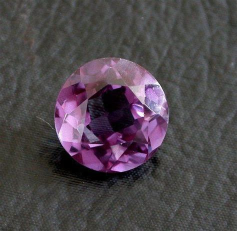 one 15mm synthetic corundum amethyst color gemstone