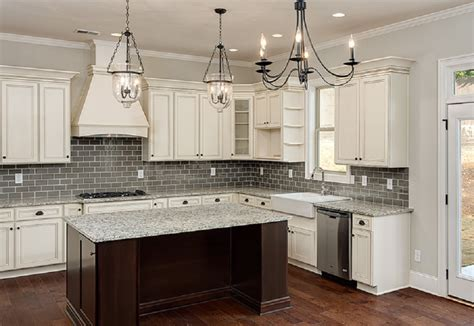 antiqued white kitchen cabinets shaker cabinets white kitchen island mediterranean