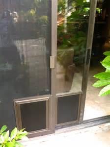 Screen Doors With Pet Door by Sliding Screen Door Door Jacobhursh