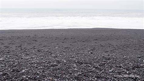 black sand walking reynisfjara black sand beach in iceland the