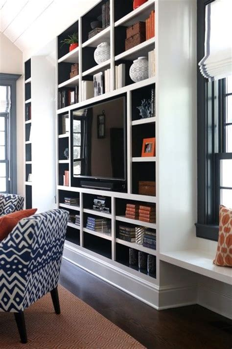 wall units with desk tv and bookshelves back of built ins painted navy blue contemporary living