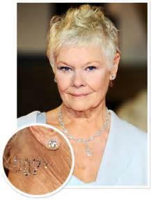 judi dench wore a 007 crystal tattoo to the london skyfall