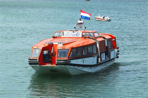 small boat tender docked vs tendered two ways to get ashore cruise critic