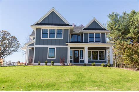black exterior windows board and batten vinyl siding exterior farmhouse with