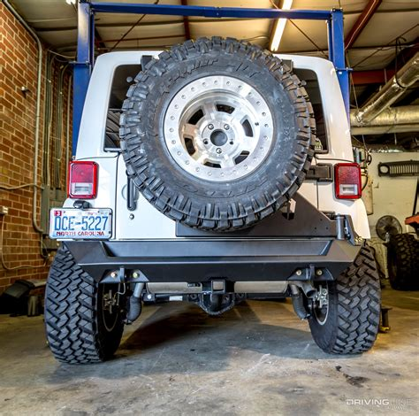 jeep rear bumper with tire carrier fab fours jeep wrangler jk off the gate tire carrier
