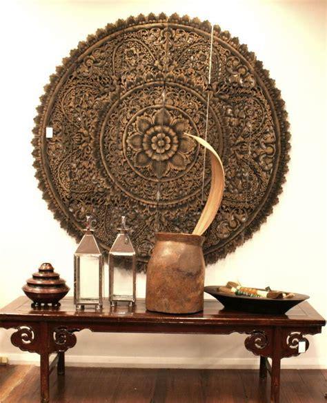 25 best ideas about thai decor on mediterranean deck lighting carved wood wall