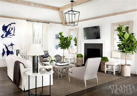 white and gray living room with tilted flat panel tv