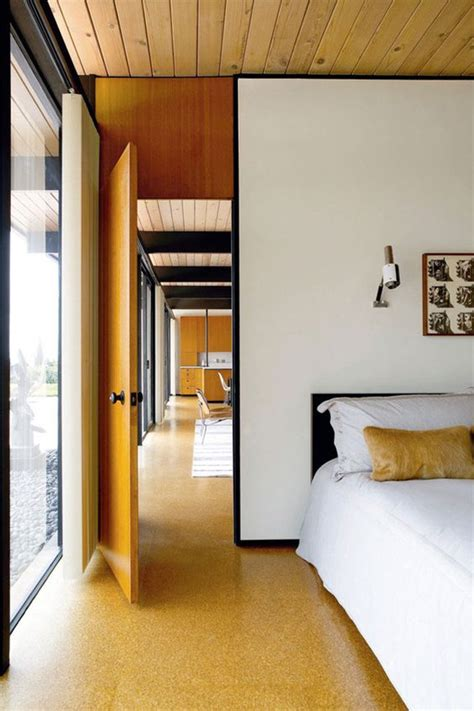 picture of cork floors highlight the mid century modern decor of this bedroom