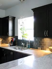 glass backsplash and black cabinets kitchens