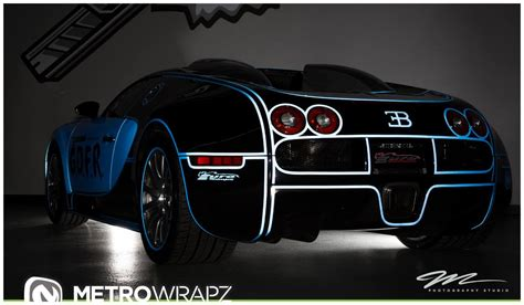 tron koenigsegg flo rida s tron wrapped bugatti veyron in all its glory