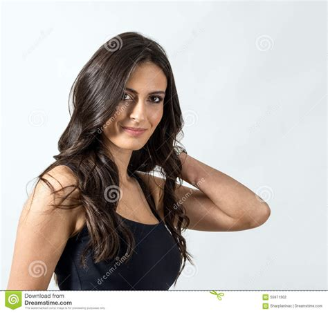 hair styles for hispanic hair seductive latino beauty with hand holding her dark healthy