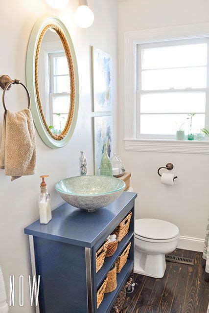 diy budget bathroom renovation with a metal cabinet converted into a vanity with a glass vessel