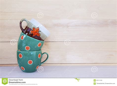 how many copies of a cup of christmas tea sold stack of cup cup on wooden table with copy space stock photo image 63111153