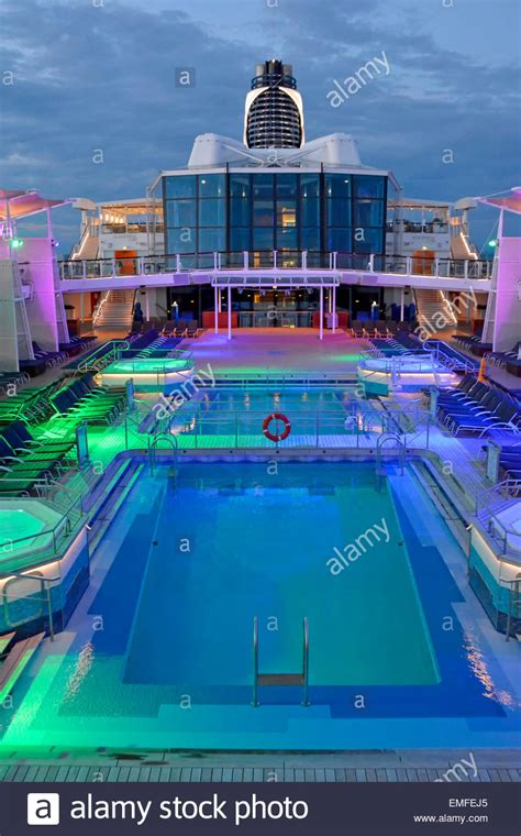 flood lighting on cruise ship pool deck at end of day with