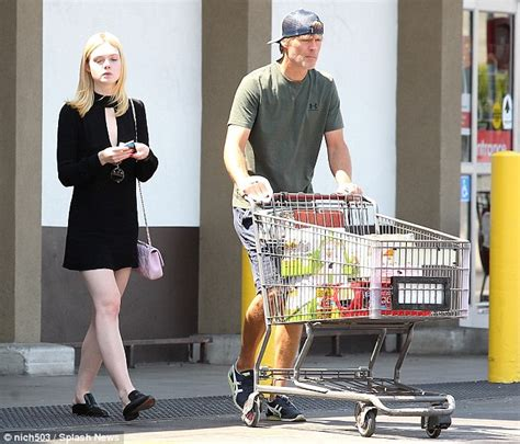 Look Chic While Grocery Shopping by Fanning Looks Stylish In Lbd As Steve Helps
