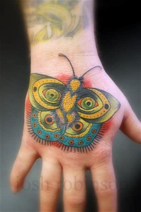 new school butterfly tattoo new school hand butterfly tattoo by obscurities tattoo