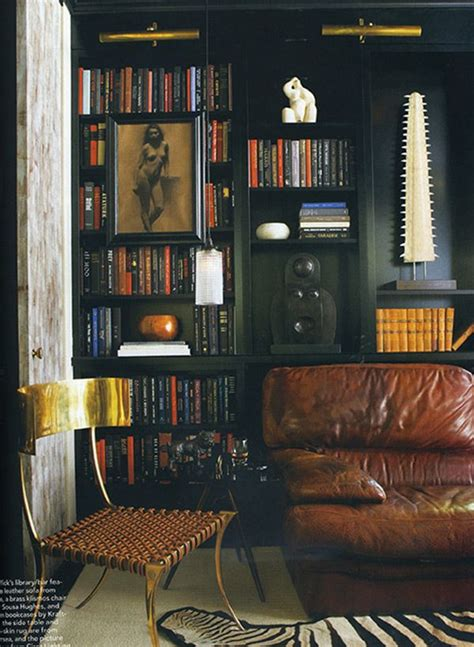masculine black bookshelves  elle decor  images