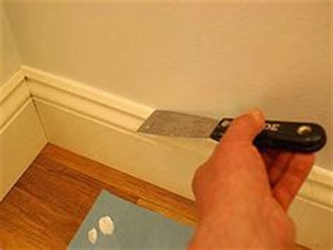 Applying wood filler to gaps on outside corners of trim