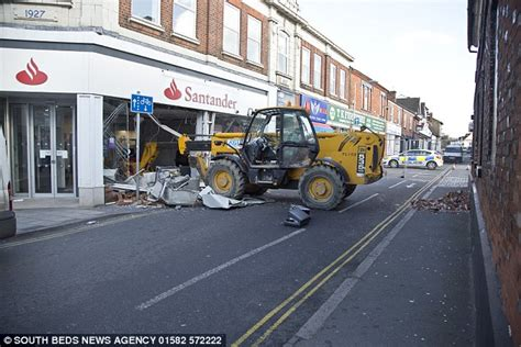 santander bank hamm robbers use jcb digger to smash into santander bank in bid