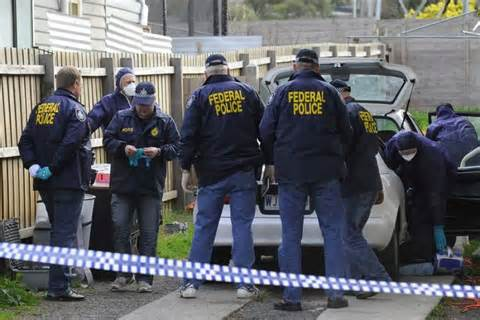 Federal Officer by Australian Federal Officers And Forensic