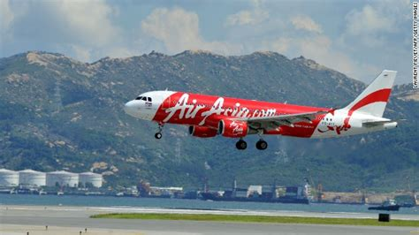 airasia member china watch canada flight diverted after passenger