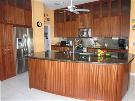sapele kitchen cabinets glass cabinet doors reflect light kitchen gleam kitchen