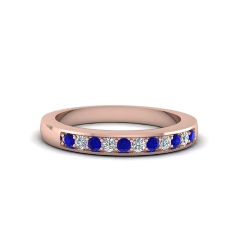 thin pave wedding band with blue sapphire in 14k