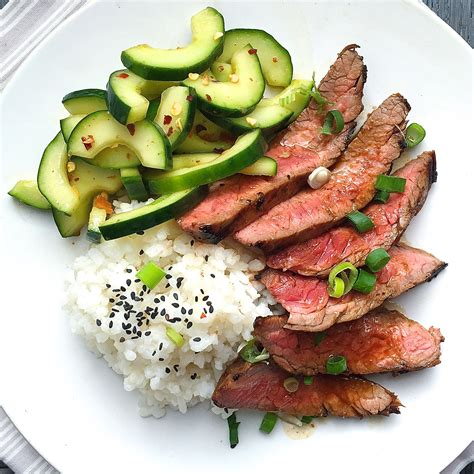 best korean style grilled flank steak with sticky rice and spicy cucumber salad recipe how to