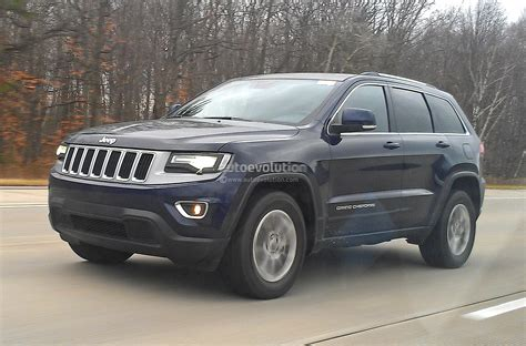 camo jeep grand cherokee spyshots 2014 jeep grand cherokee facelift loses almost