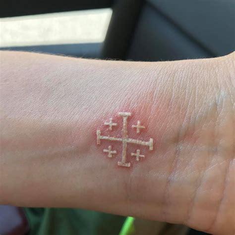 white cross tattoo getting tattoos on pilgrimage to jerusalem