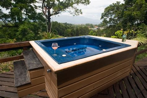 hot bathtub incorporating a hot tub into a small but luxurious space