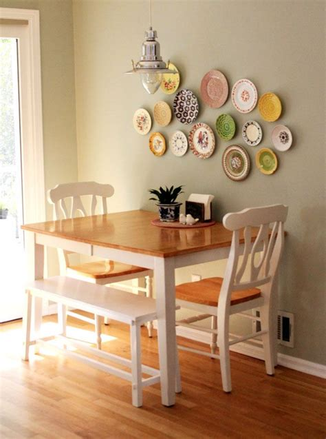 small dining room decor table against the wall two chairs one bench seat