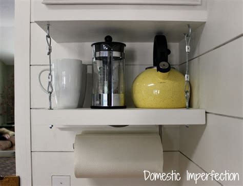 under cabinet shelf kitchen how to raise your cabinets add a shelf domestic