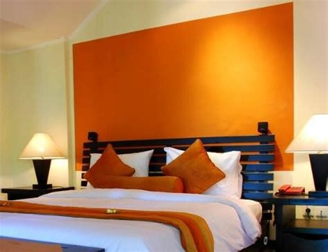 orange accent wall dreamy bedroom