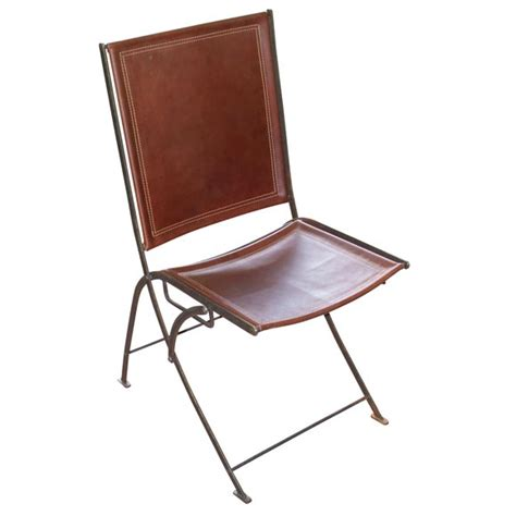 leather folding chair leather and steel caign folding chairs at 1stdibs