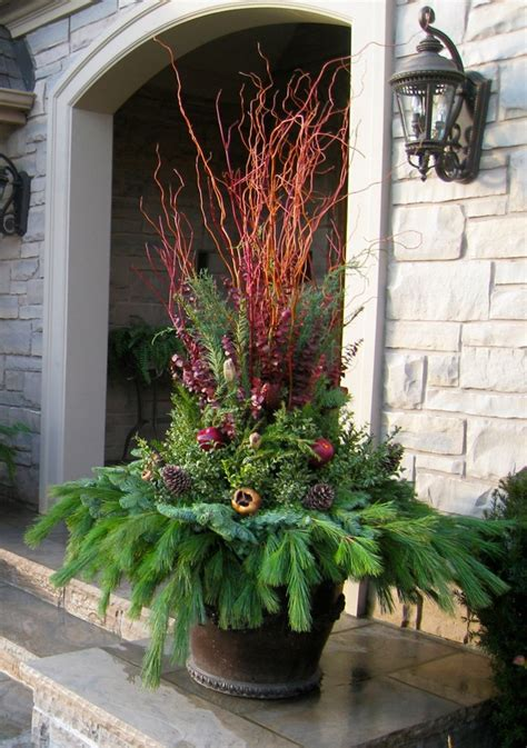 outdoor winter planter ideas 1000 images about porch pots winter on