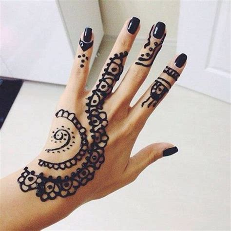 black henna tattoo on hand henna on