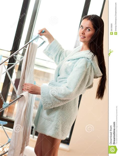 Womans Rack Beautiful Hanging Freshly Washed Clothes On The Rack
